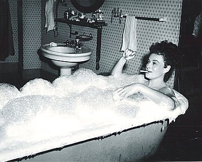 "PAULETTE GODDARD in her bath tub scene from ""Anna Lucasta."" Rapper described Goddard as ""a courtesan."""