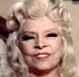 "MAE WEST, falling apart in her 80s, was the star of ""Sextette,"" one of the last films Rapper worked on."
