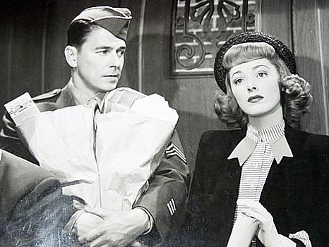"RONALD REAGAN with ELEANOR PARKER in ""Voice of the Turtle,"" a film Rapper wasn't too happy with when it was finally finished."