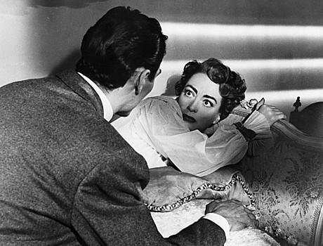 "JACK PALANCE throws a scare into JOAN CRAWFORD ina scene from""Sudden Fear."""