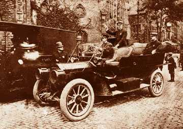 This could be the city's first police car. While there is nothing on the back of the photo that identifies it as such, it appears to be a Packard from around 1909 or 1910, the vintage purchased for the department by Frank Croul. The officer standing in the backseat is identified as Burton Girardin, grandfather of Ray Girardin who was police commissioner in the 1960s.
