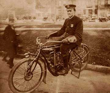 A Detroit police officer in 1910 on a Detroit Police Department motorcycle. Detroit's department was an early pioneer in motorization.