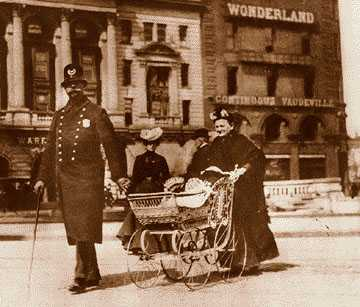 Police in the 19th century were confined to foot patrol, but had a close relationship with the community, as shown by this officer from the Detroit police Broadway Squad helping a woman and her baby cross Woodward in 1898.