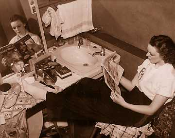 This photo, part of a Detroit News feature article that suggested Fox chorus girls spent their time reading romance magazines, touched off an angry reaction that ended with the girls challenging the News to find six Detroit women for them to debate in an intelligence contest.