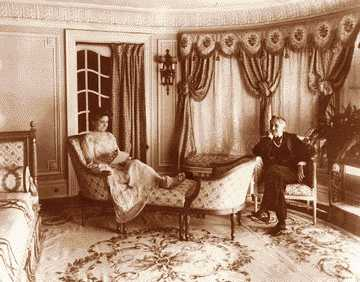 Mr. and Mrs. William Muir Finck in a parlor of their Van Dyke mansion. Finck made his fortune from blue jeans.