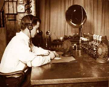 Police radio operator B.D. Fitzgerald at the controls of the radio dispatch equipment at Detroit Police headquarters in 1925.