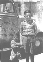 John Pratt and friend in front of a Wing Hing Long delivery truck, about 1950.